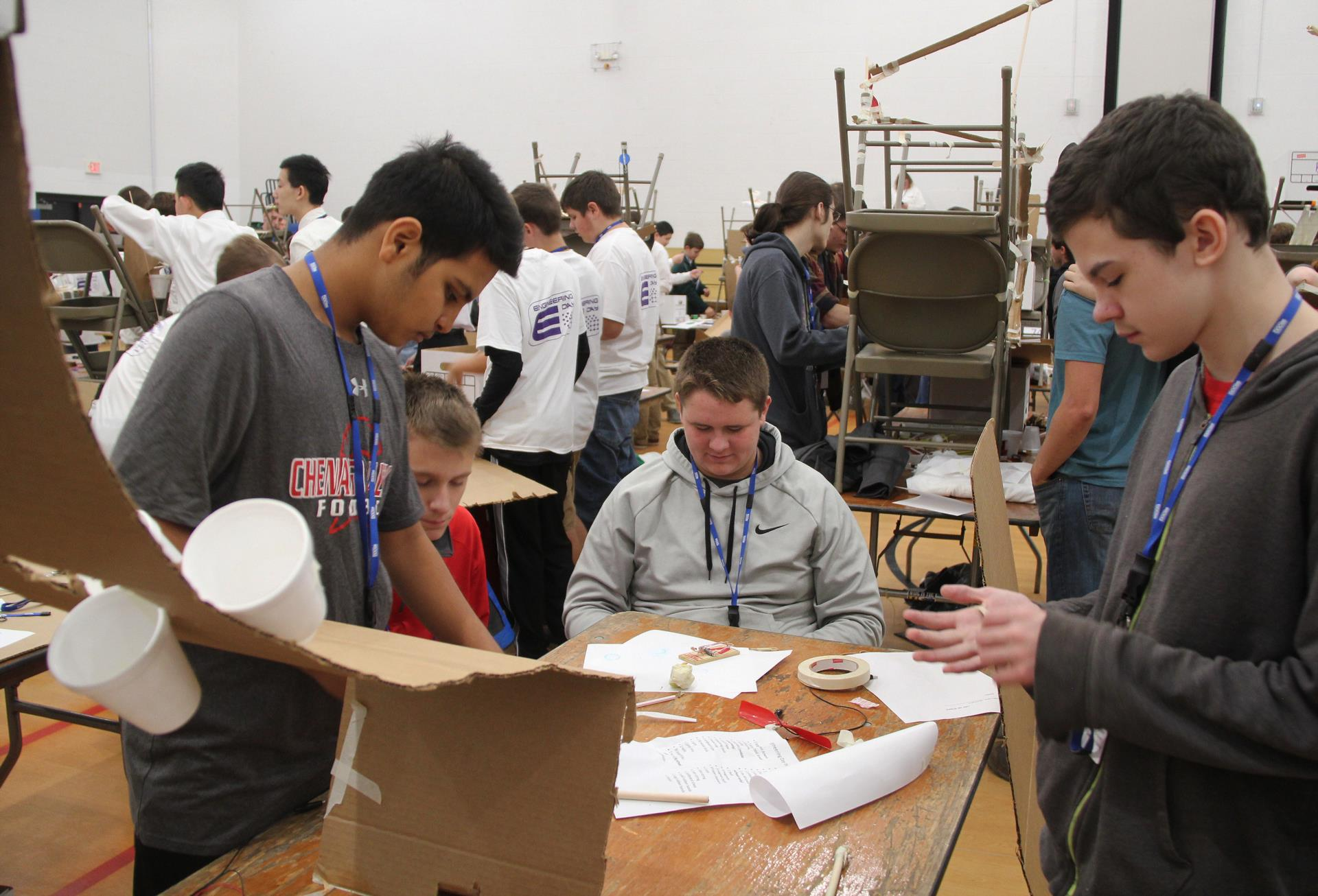 high school students working on engineering day project