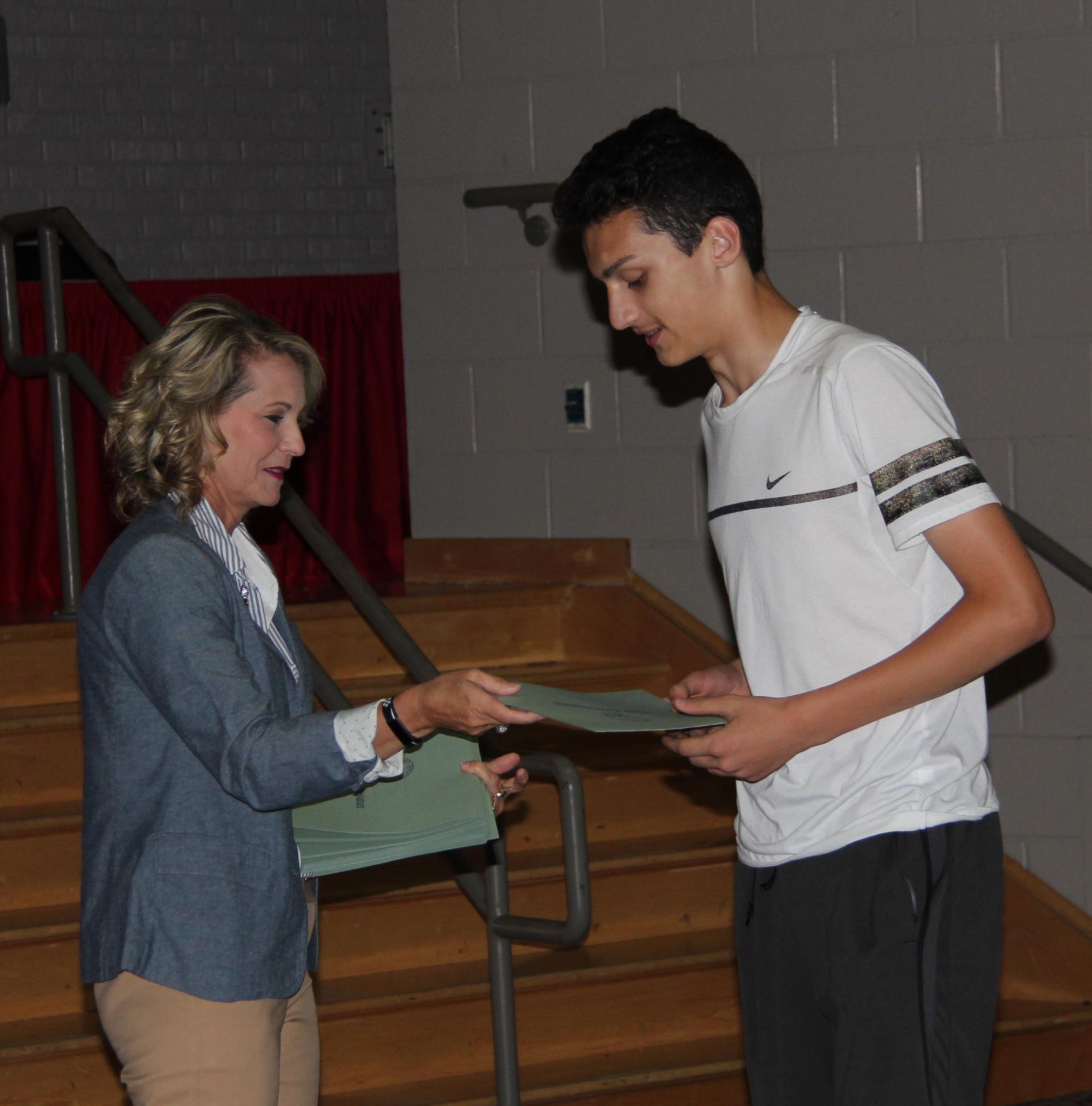 legislator handing student certificate