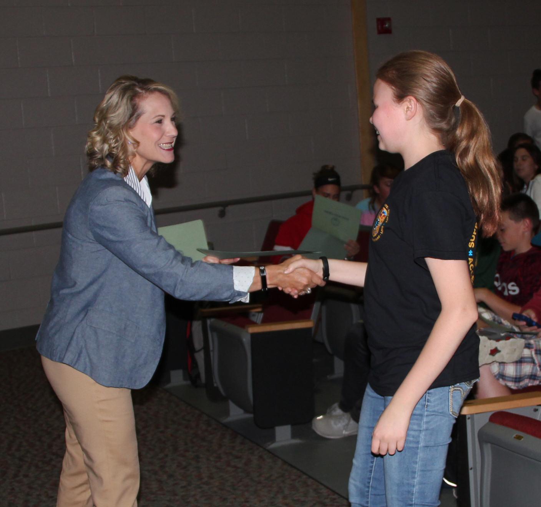 legislator shaking students hand