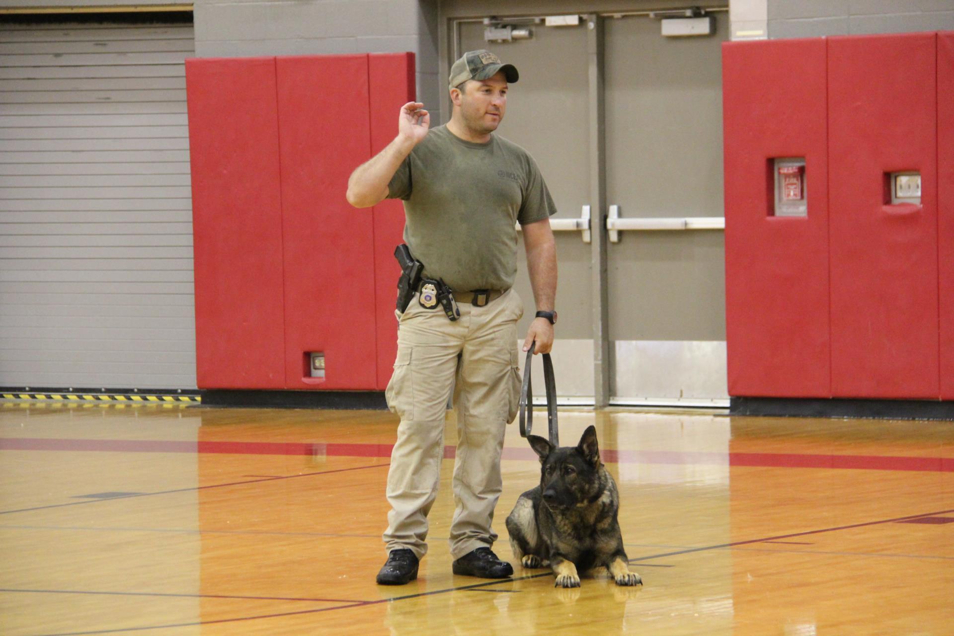 man standing next to dog