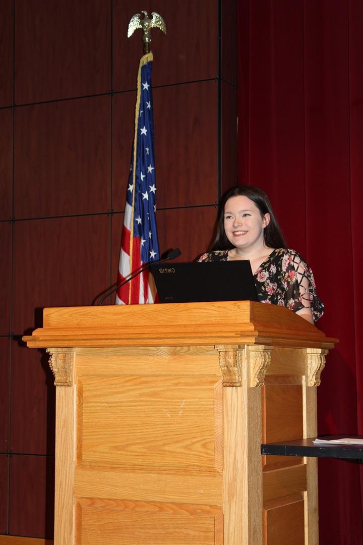 natalie speaking at podium
