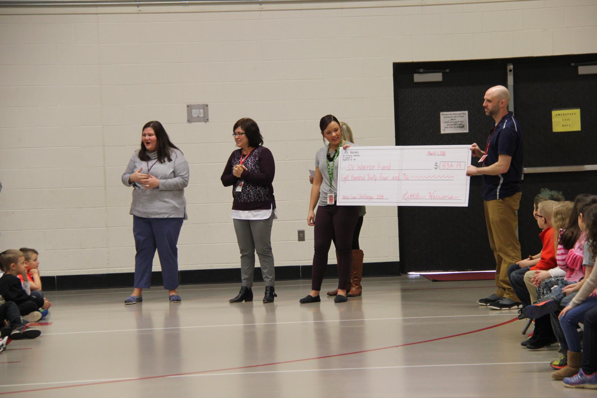 port dickinson elementary presenting check to warrior fund