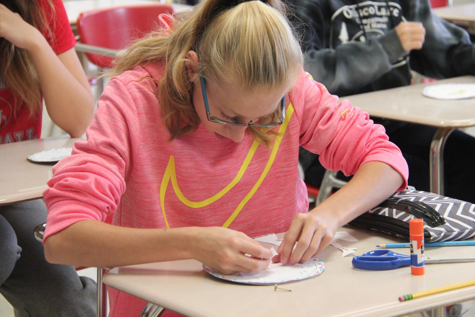 student creating clock