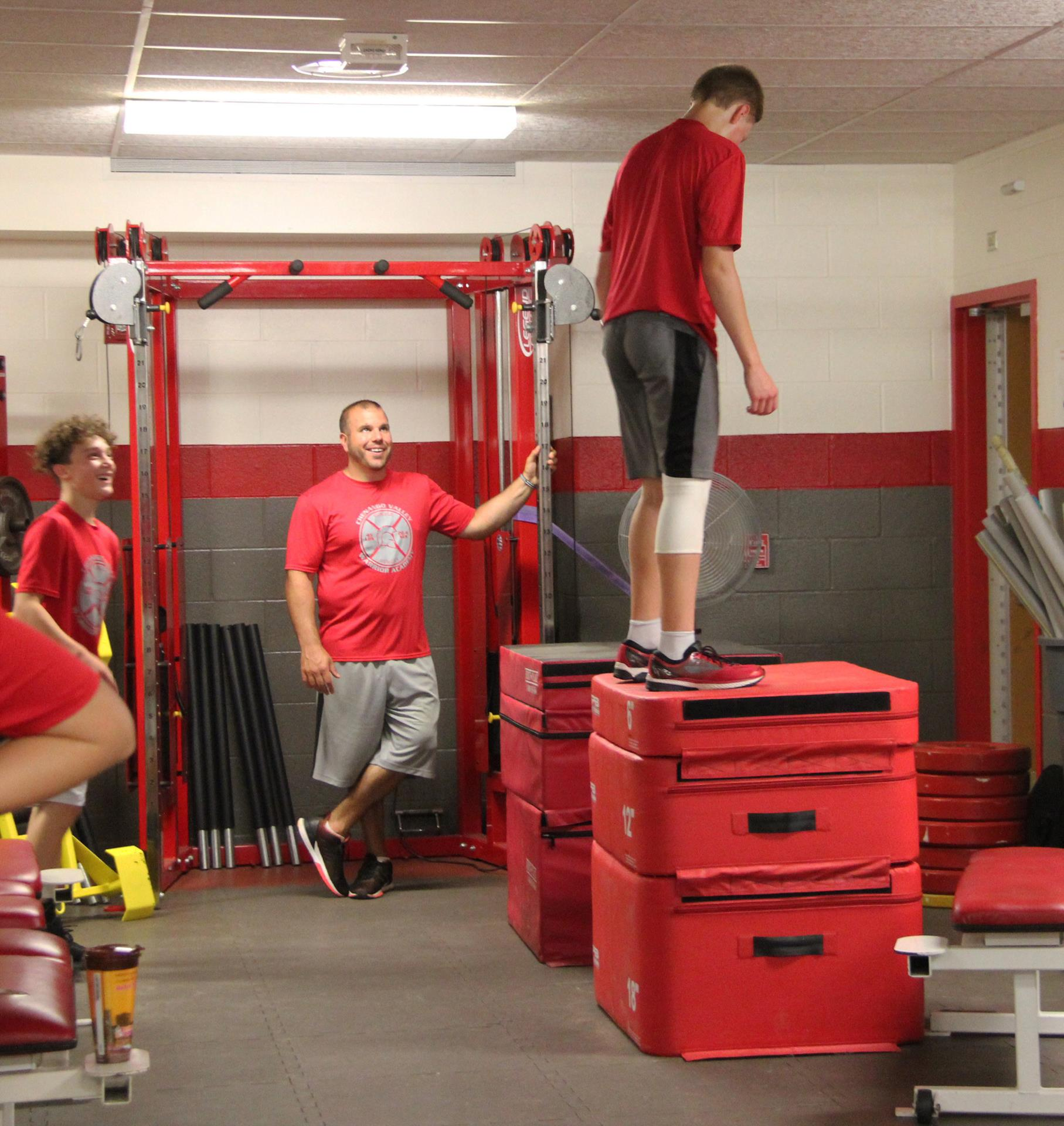 student doing box jump exercise