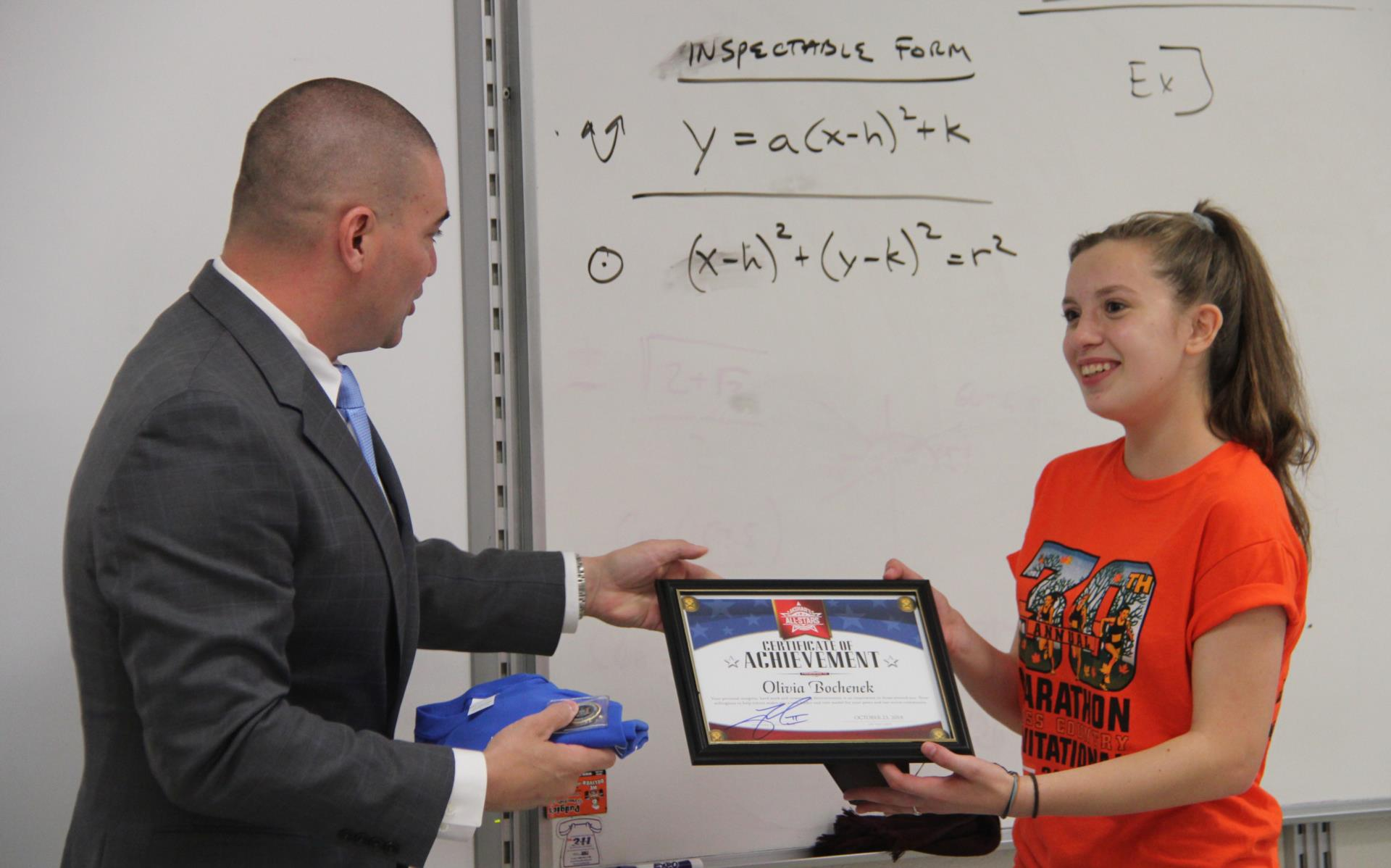 student receiving plaque