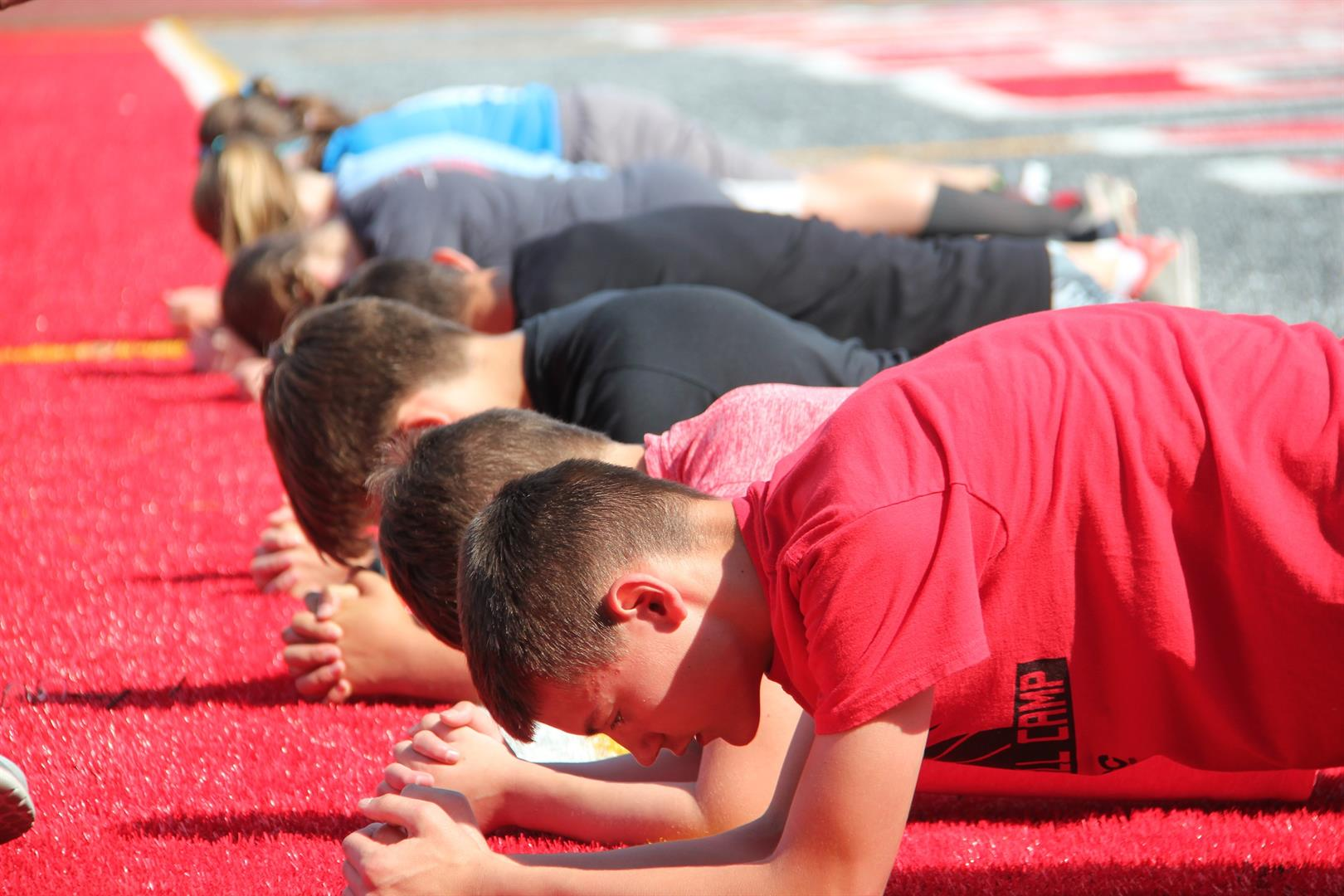 students doing planks at warrior academy 2017