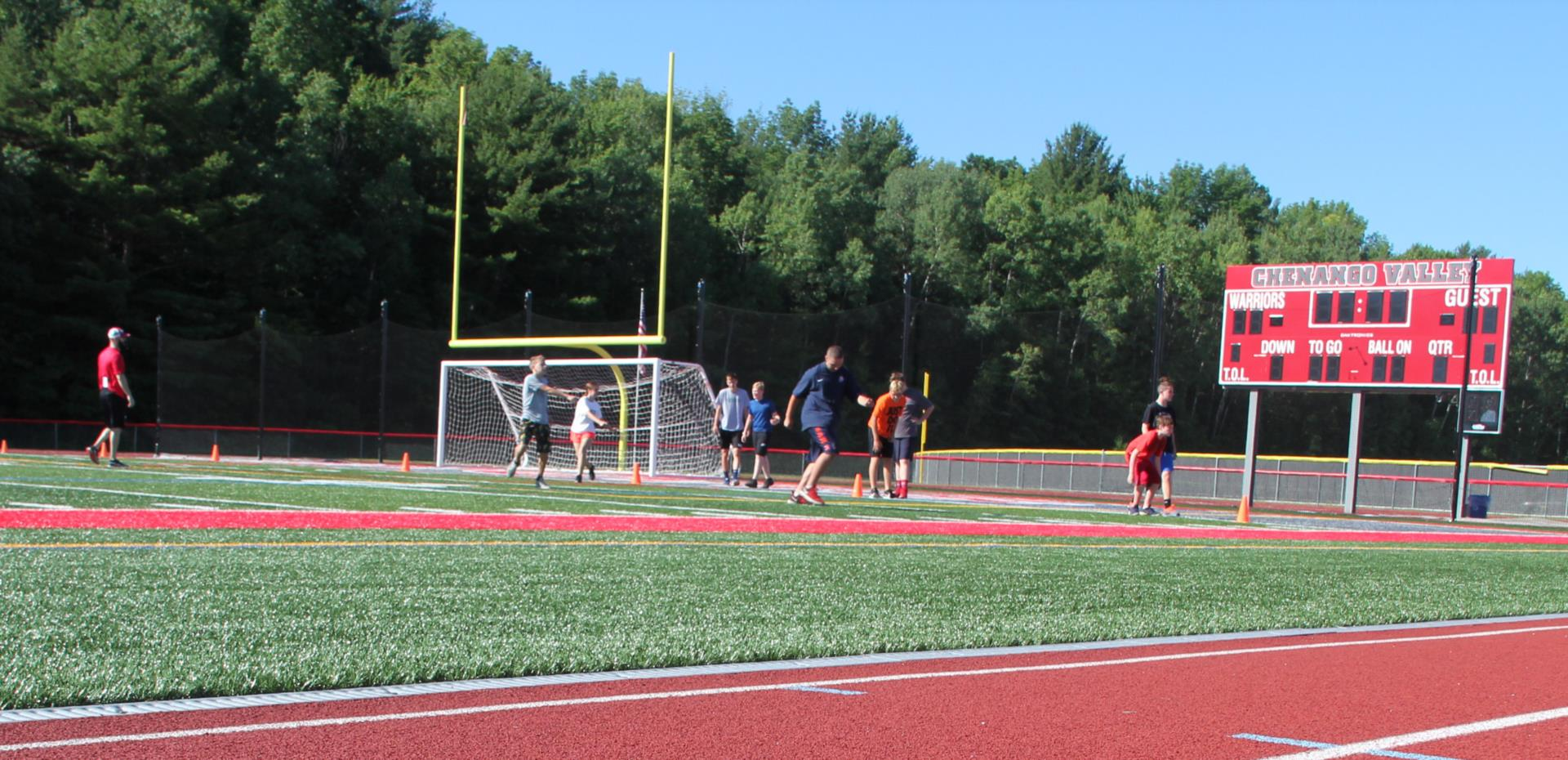 students exercising on turf