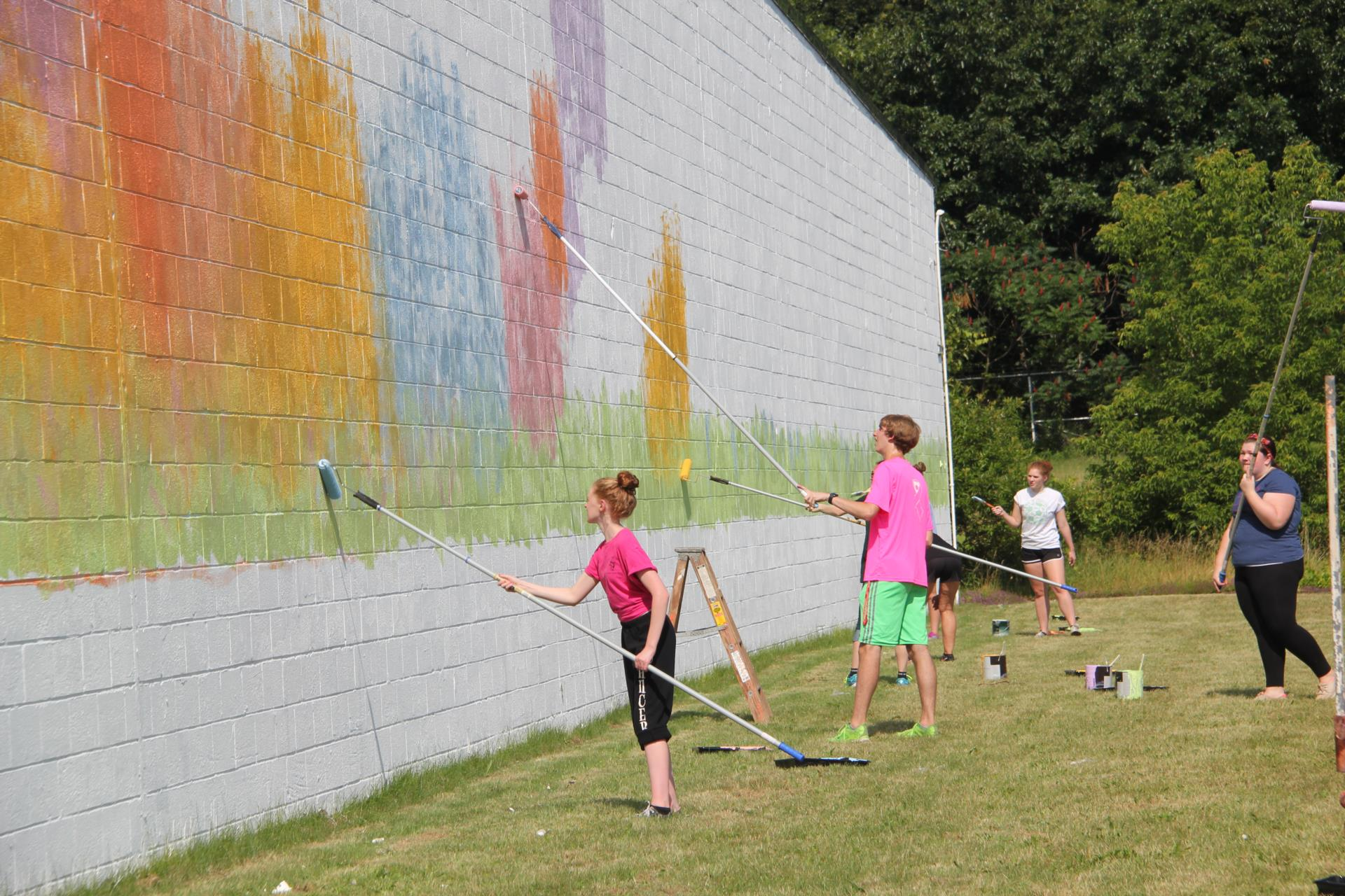 students painting mural