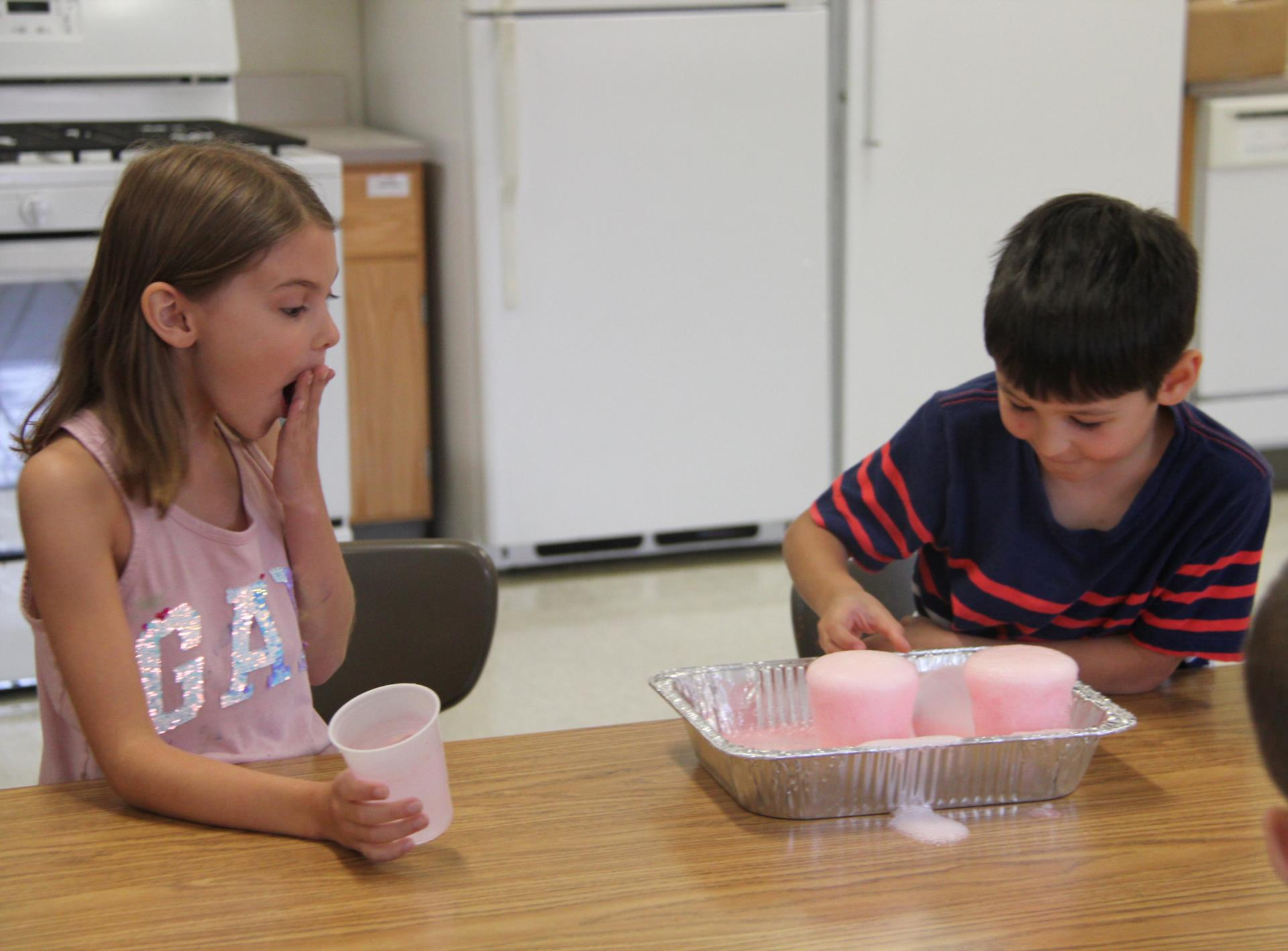 students performing volcano experiment