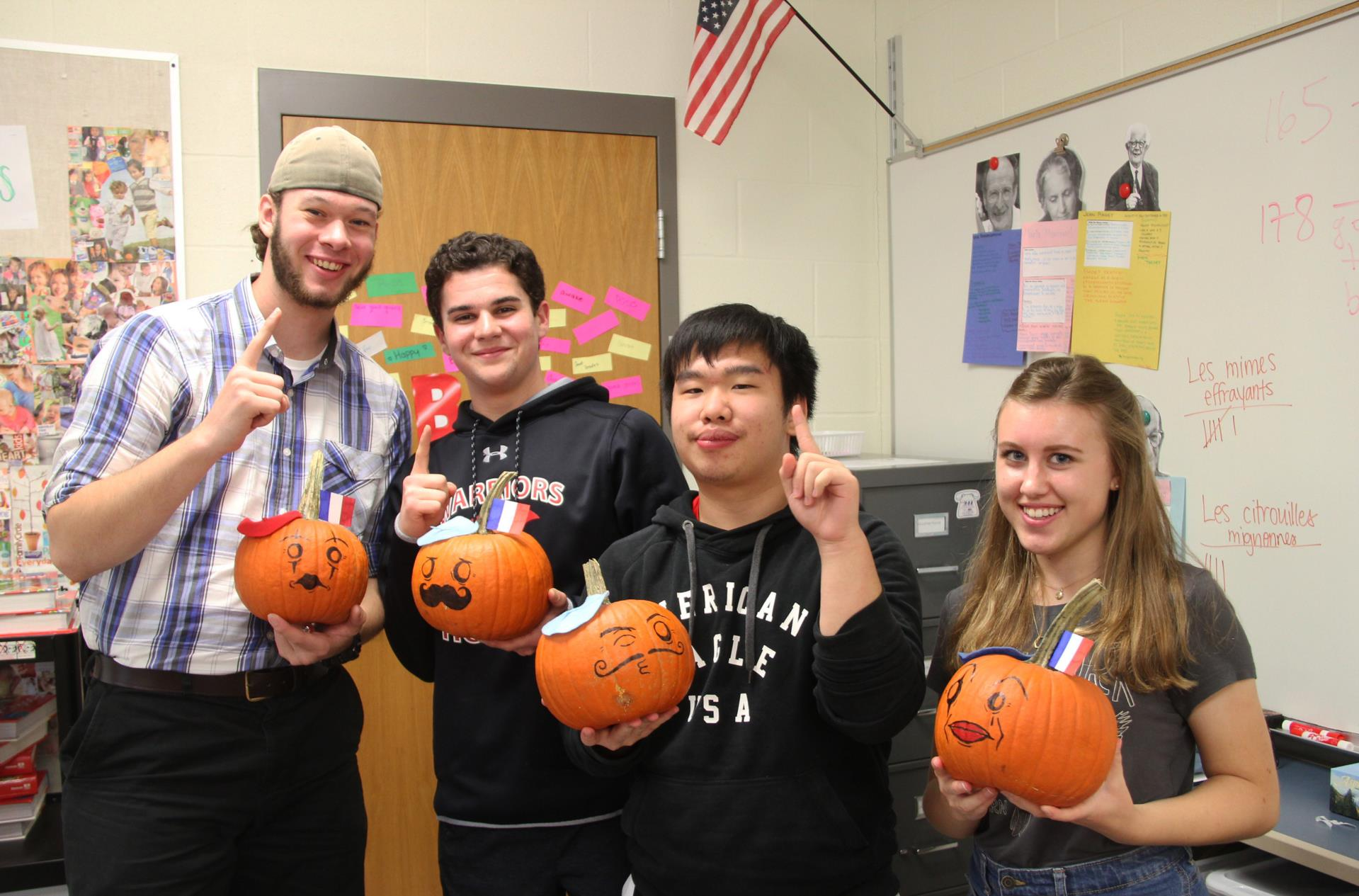 students with prize pumpkins