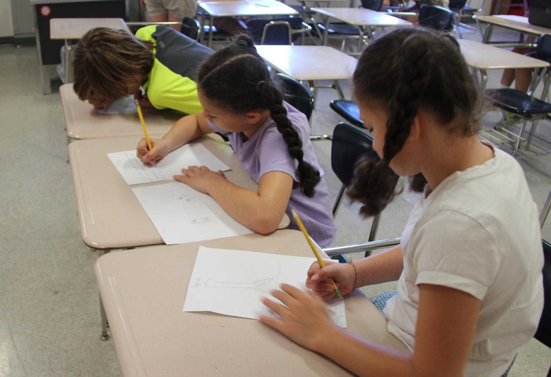 students writing research information on paper