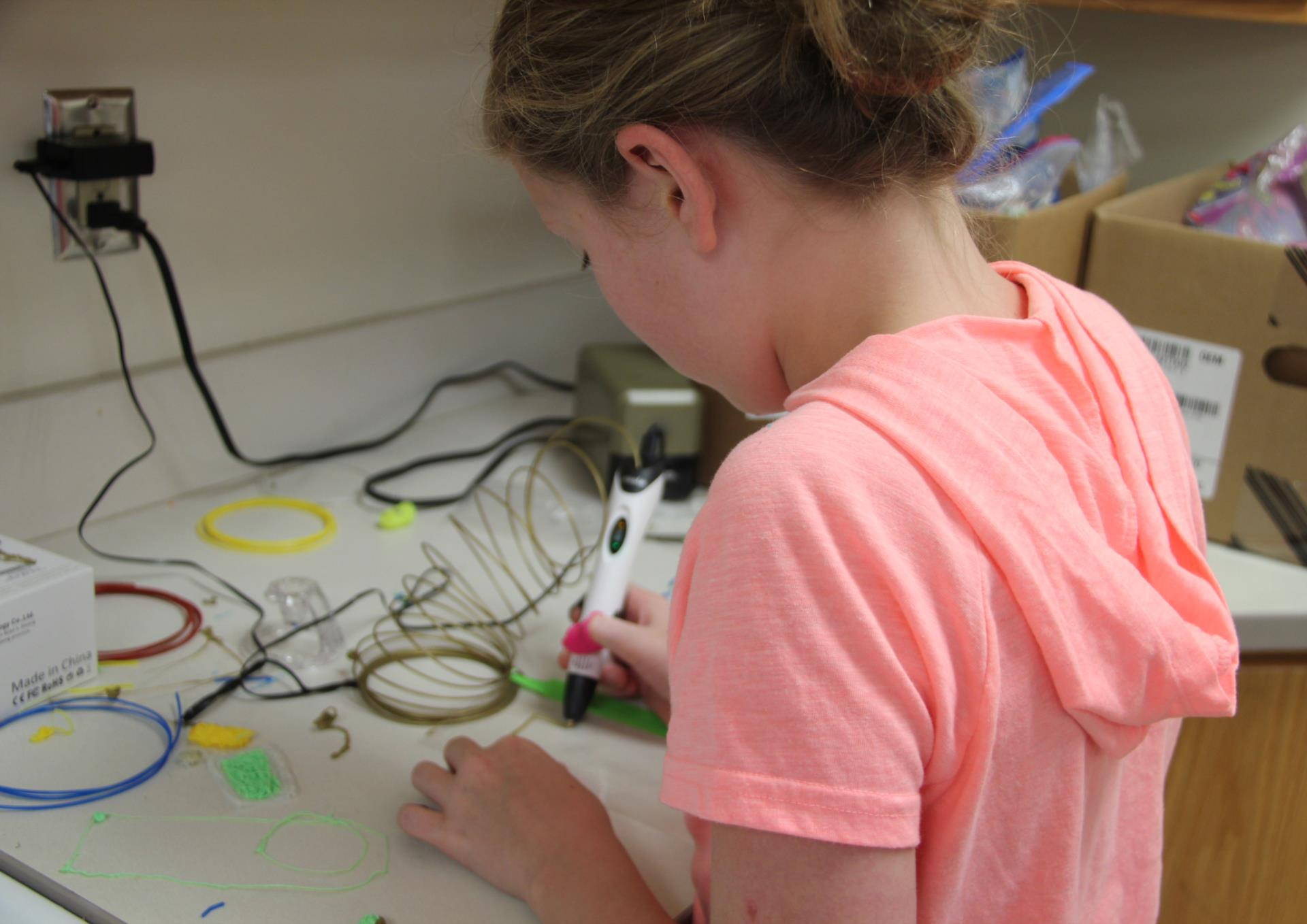 student working with 3 d pen