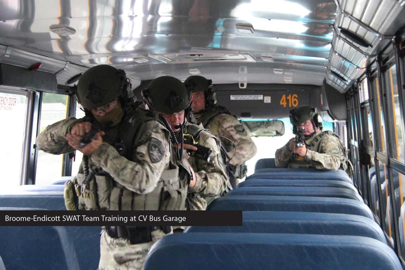 swat team on bus