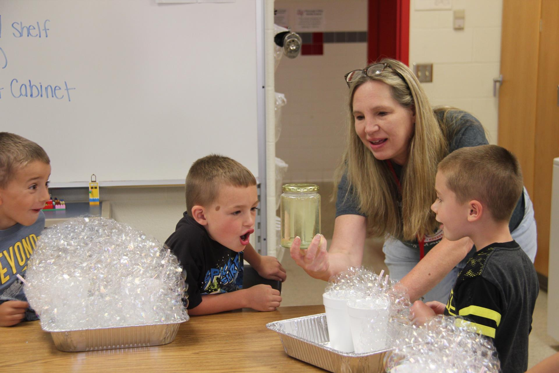 teacher showing students tornado in a glass