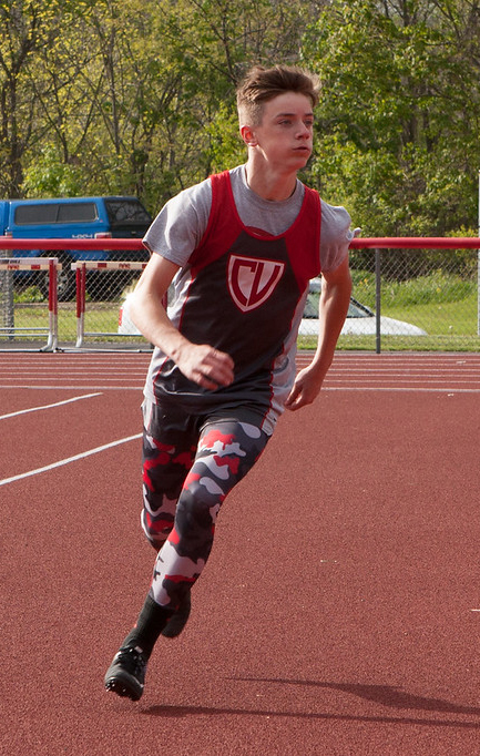 student participating in track event