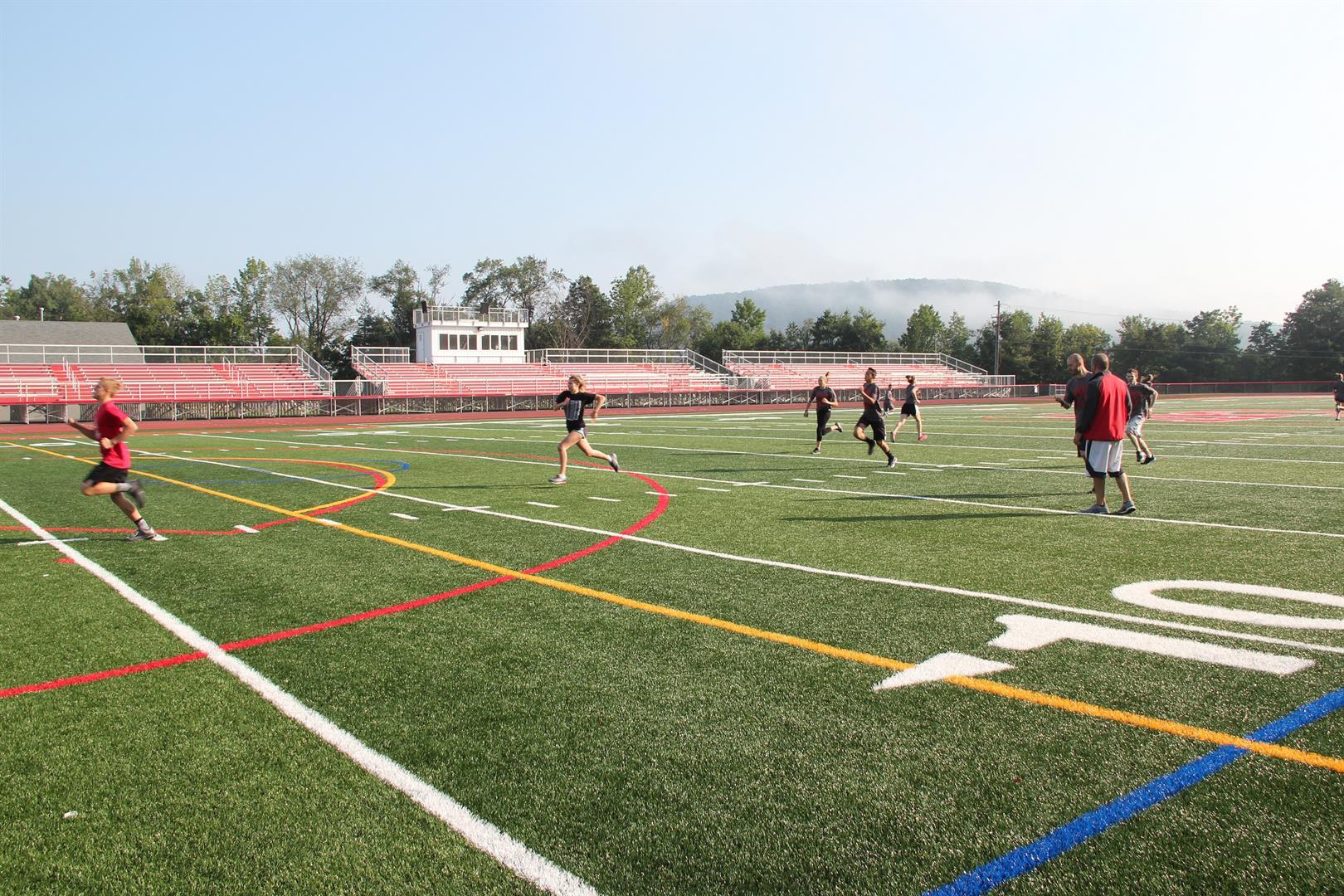 wide shot of warrior academy students running