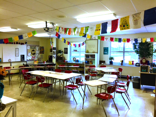 wide shot of classroom tibetan prayer flags
