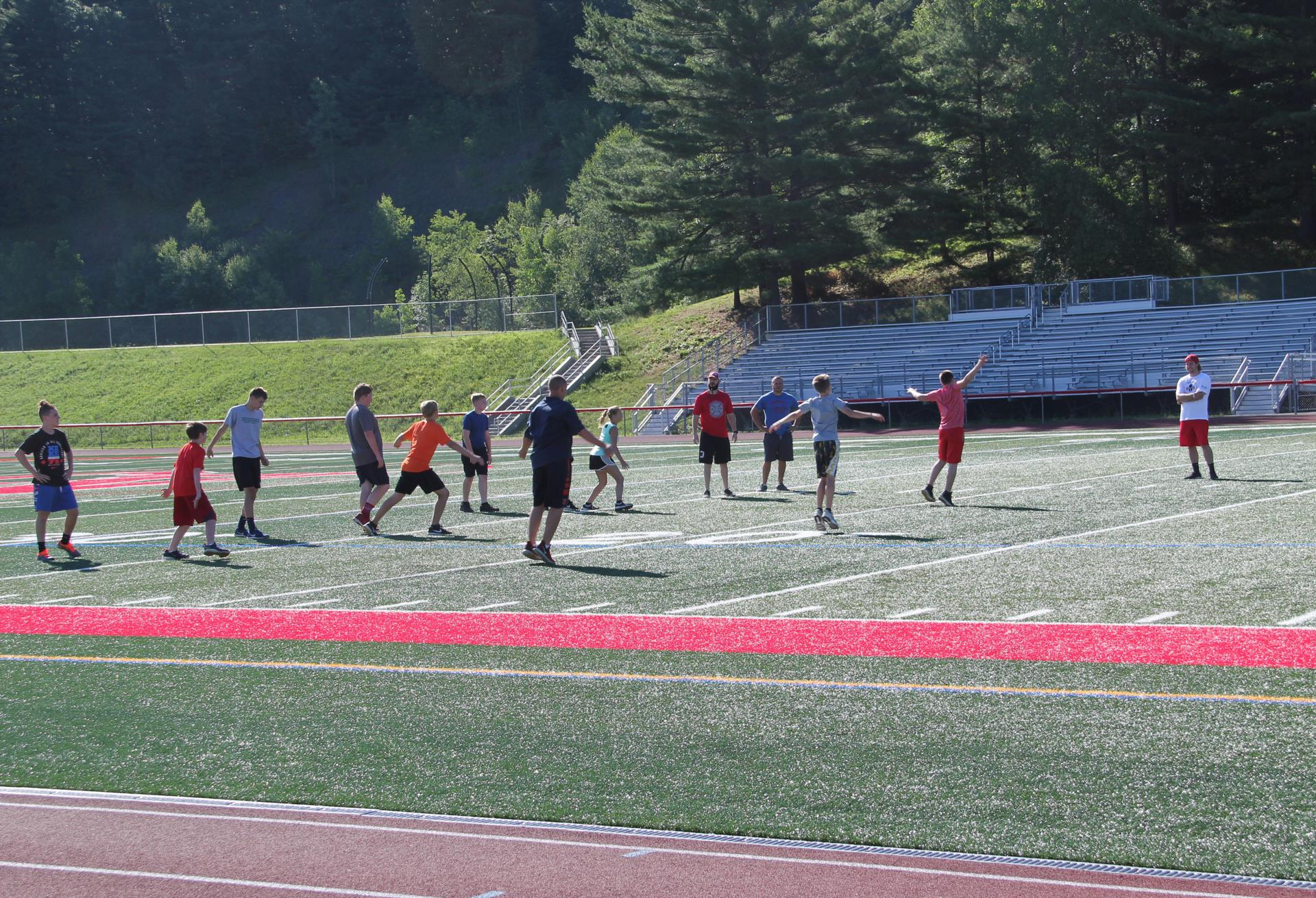 wide shot of students exercising on turf