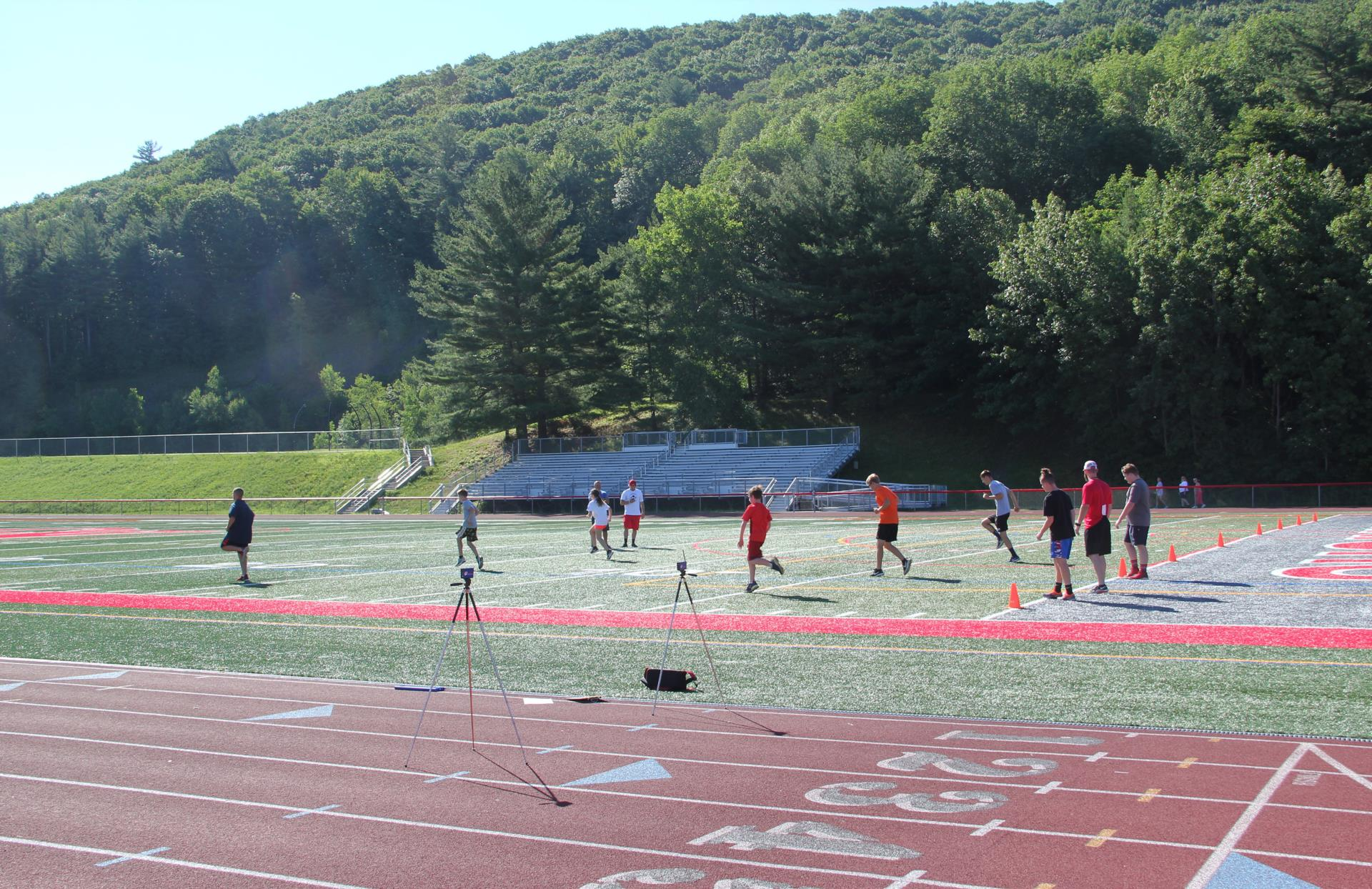 wide shot of students running on turf