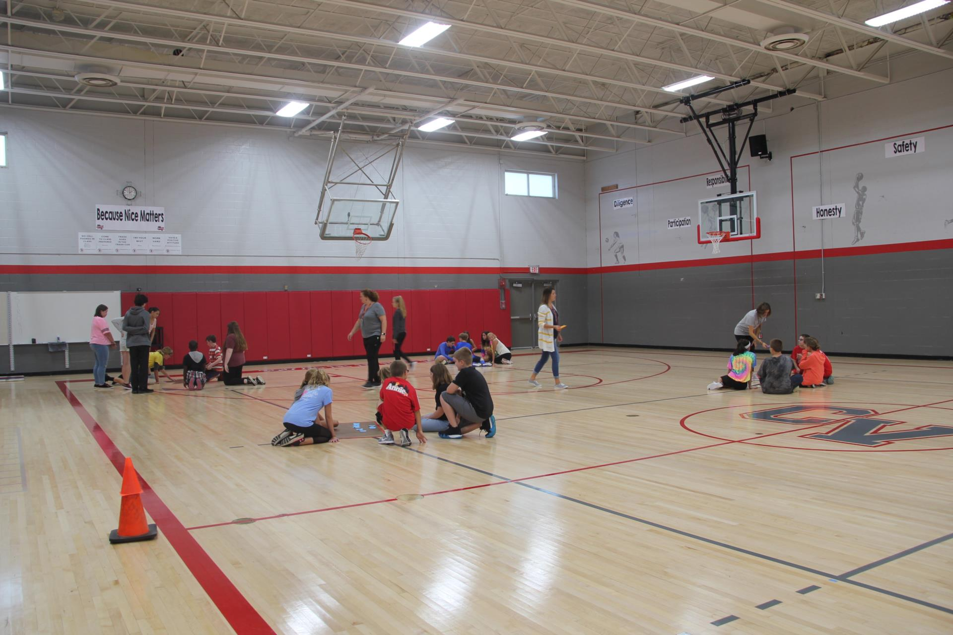 wide shot of students working on teamwork activity in gym class