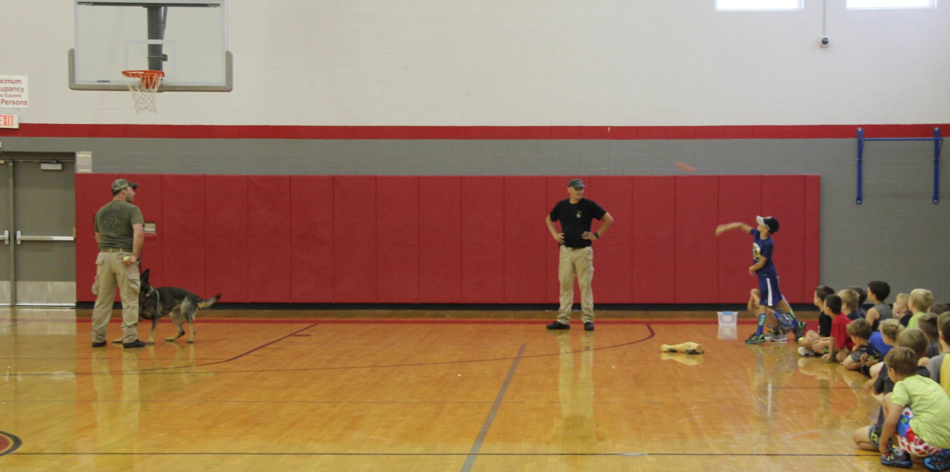 wide shot of student throwing ball