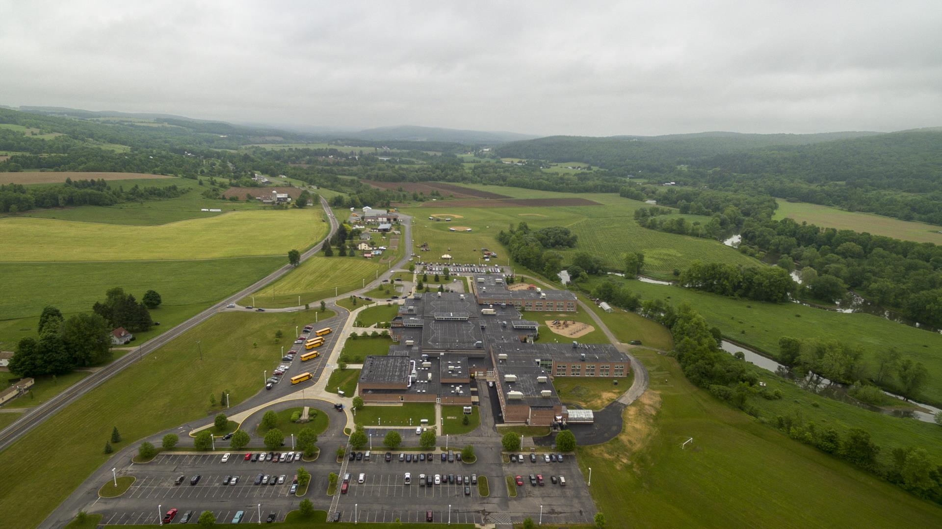 Aerial view looking a the school in foreground center and the valley headed north