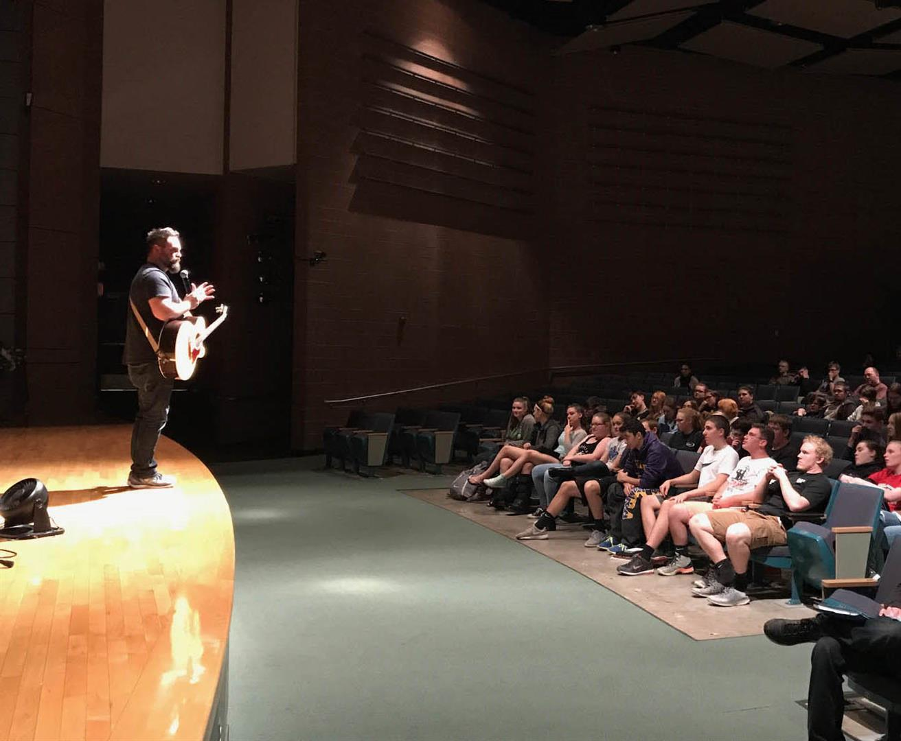 Jared Campbell is seen performing for students