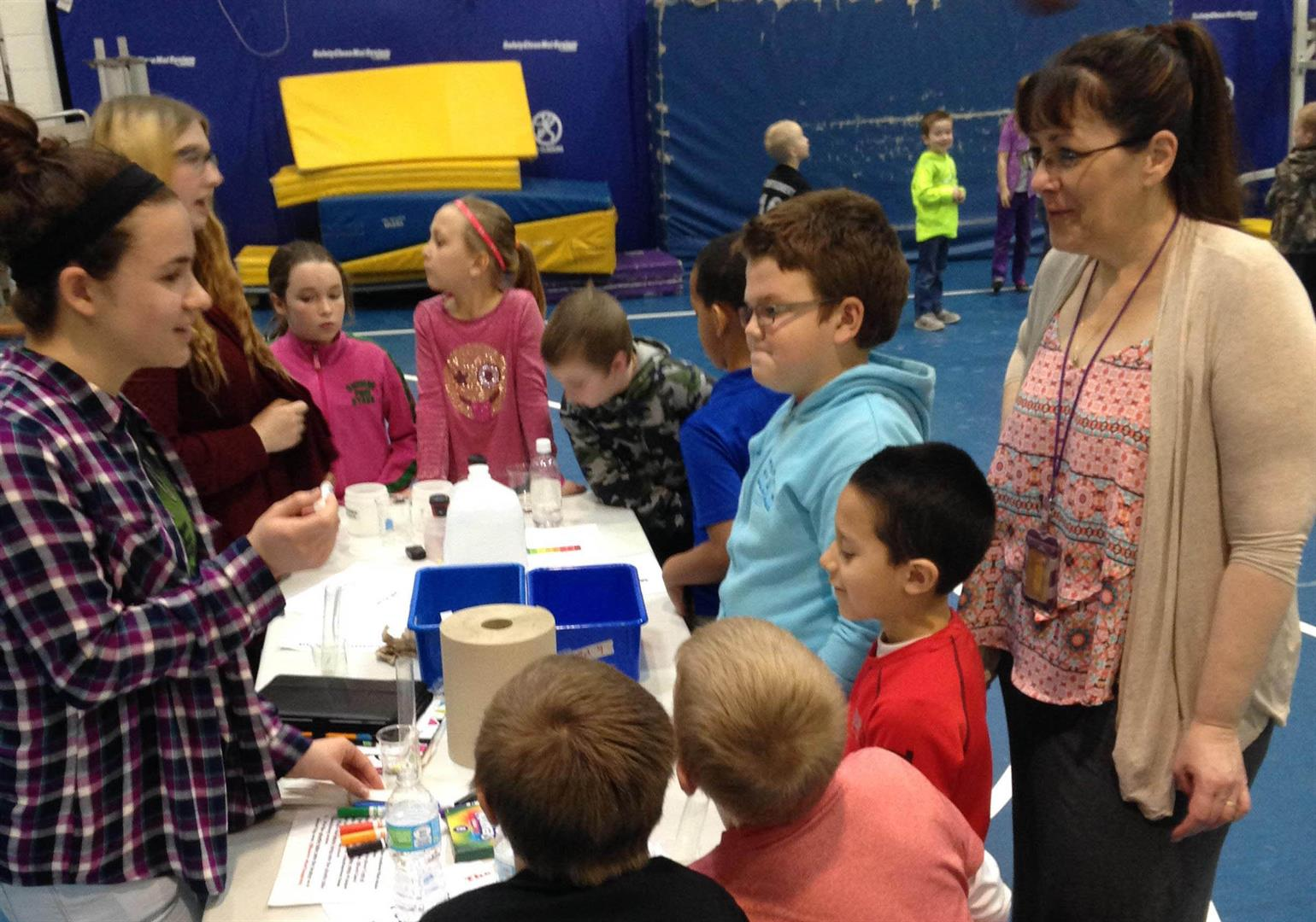 several students view a science fair