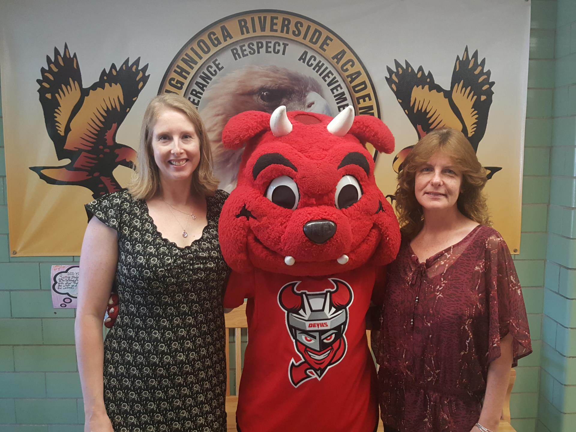 teachers with devil mascot