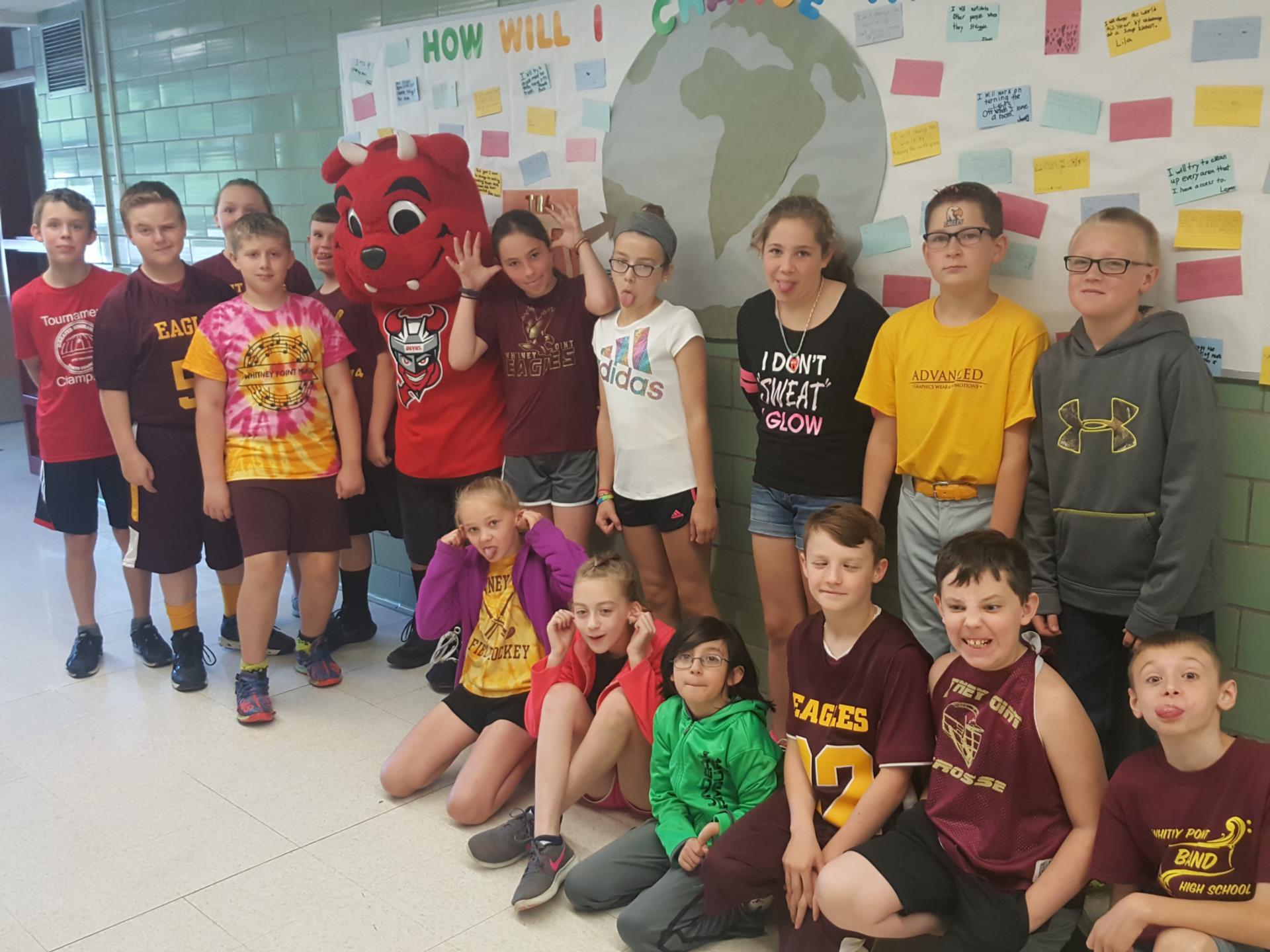 kids with devil mascot