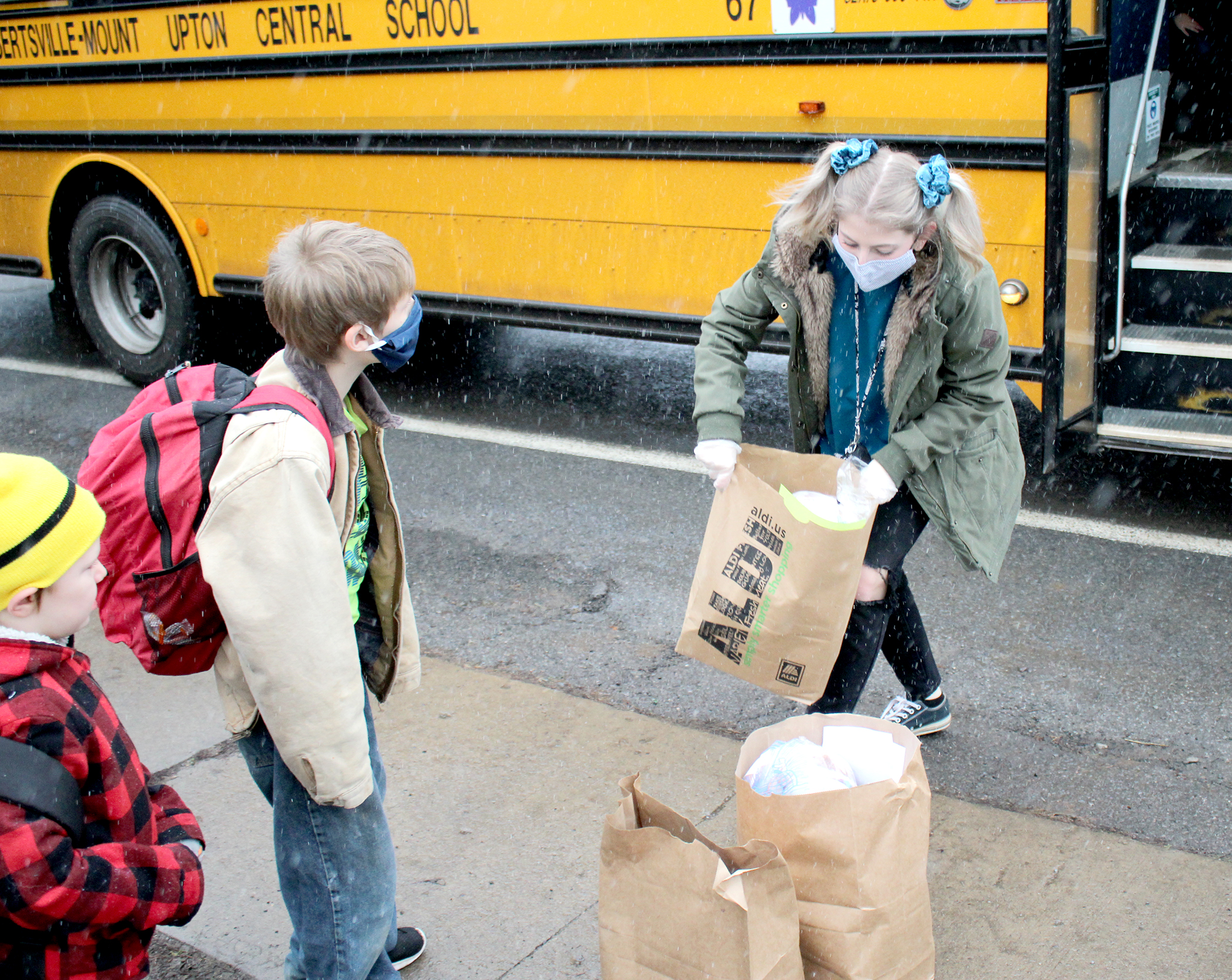 Student delivering meals from school bus (12/2020)