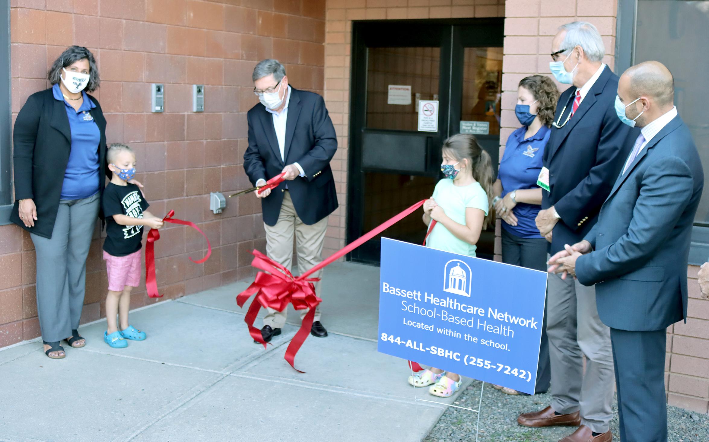 Former NYS Senator James Seward cuts a ribbon at GMU (9/2021)