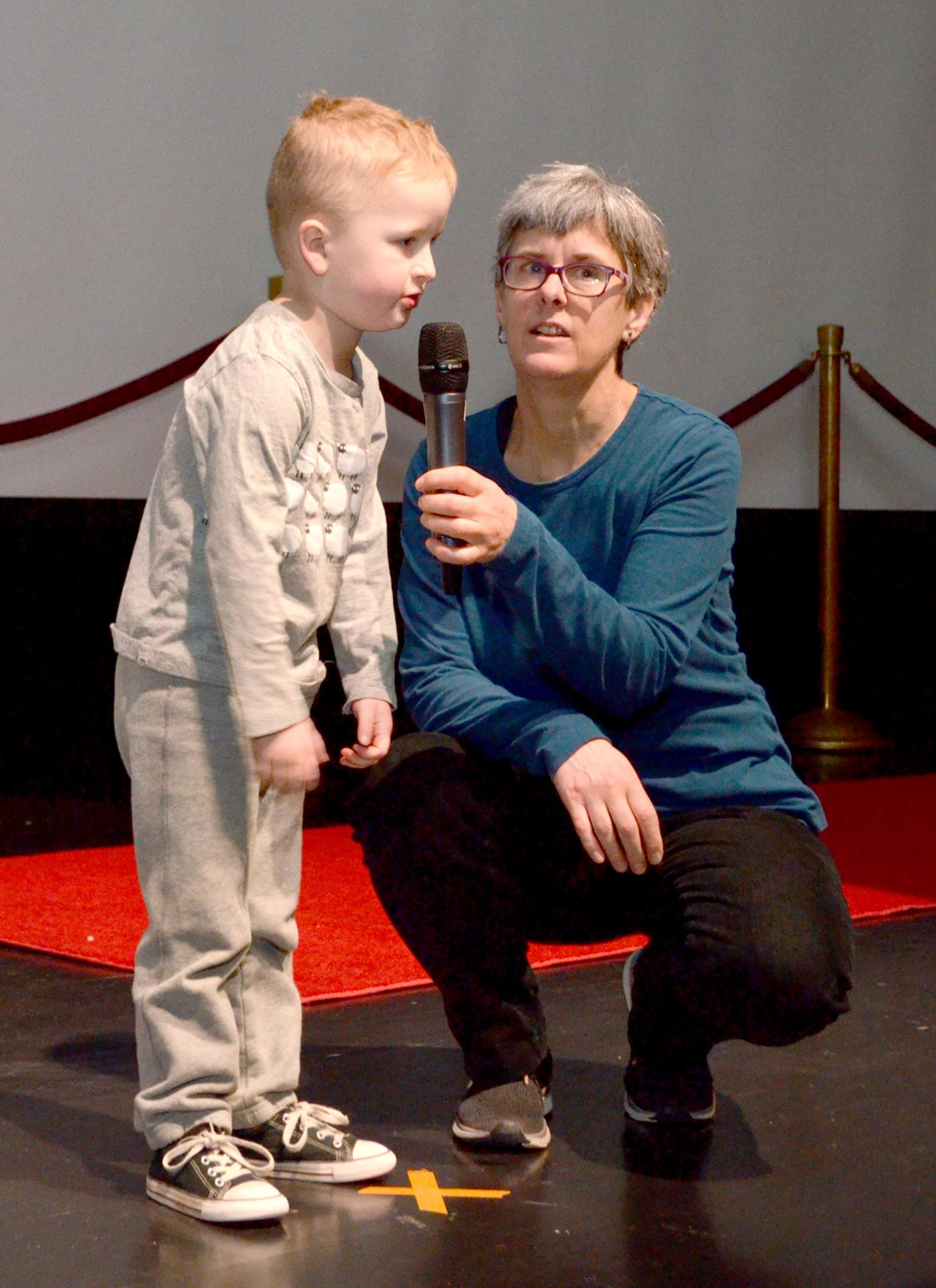 Young boy with teacher Bobbi Stensland